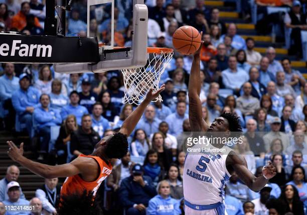 Nassir Little of the North Carolina Tar Heels blocks a shot by Tyus Battle of the Syracuse Orange during the second half of their game at the Dean...
