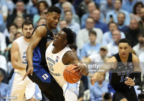 Nassir Little of the North Carolina Tar Heels collides with Javin DeLaurier of the Duke Blue Devils during their game at Dean Smith Center on March...