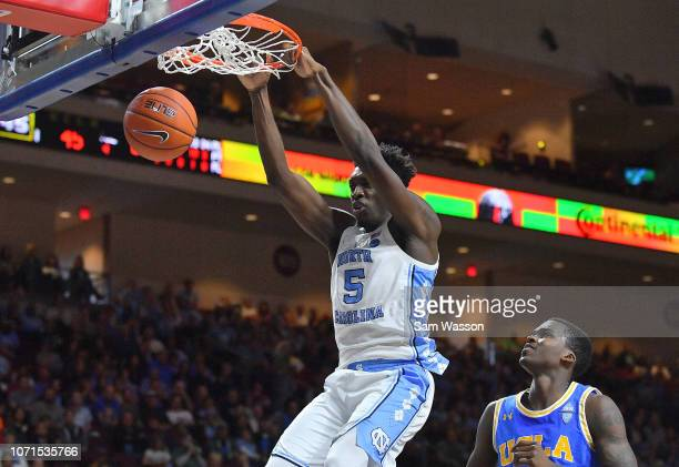 Nassir Little of the North Carolina Tar Heels dunks against Kris Wilkes of the UCLA Bruins during the 2018 Continental Tire Las Vegas Invitational...
