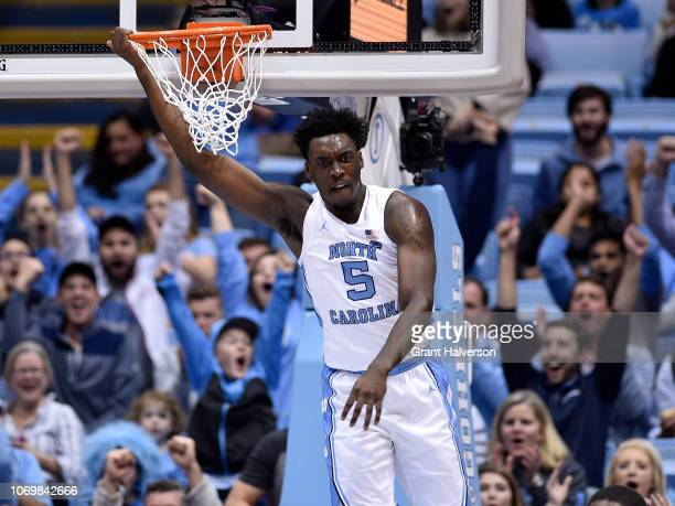 Nassir Little of the North Carolina Tar Heels hangs on the rim after dunking against against the St Francis Red Flash during the first half of their...