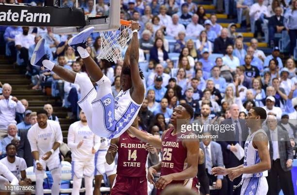Nassir Little of the North Carolina Tar Heels hangs on the rim after being fouled on a dunk attempt against the Florida State Seminoles during the...