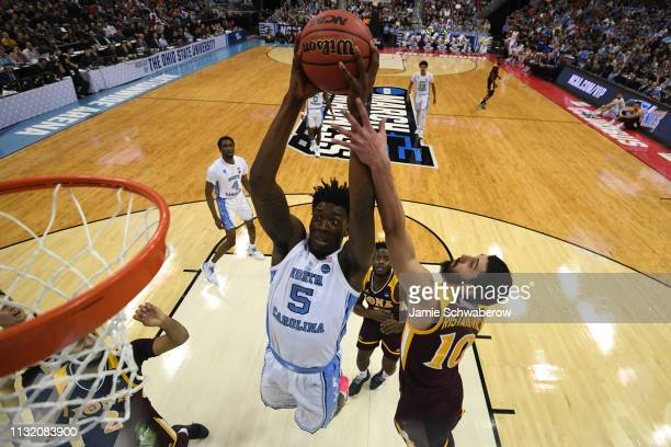 Nassir Little of the North Carolina Tar Heels tries to shoot over Andrija Ristanovic of the Iona Gaels in the first round of the 2019 NCAA Photos via...