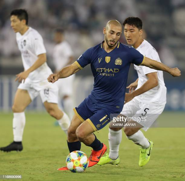 Nassr FC's Moroccan midfielder Nordin Amrabat dribbles past Sadd SC's South Korean midfielder Jung Wooyoung during the AFC Champions League...