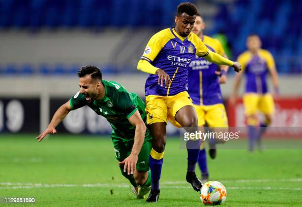 Nassr's midfielder Abdullah AlKhaibari wins the ball from Zob Ahan's Mohammadreza Abbasi during the AFC champions league Group A football match...