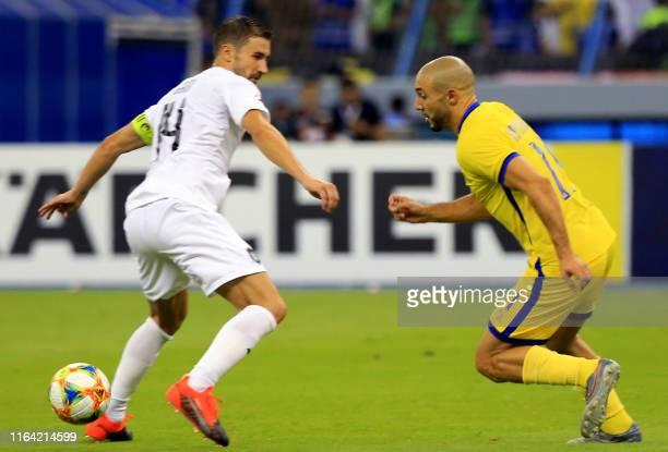 Nassr's midfielder Noureddine Amrabat dribbles past Sadd's midfielder Gabi during the AFC Champions League quarterfinals football match between...