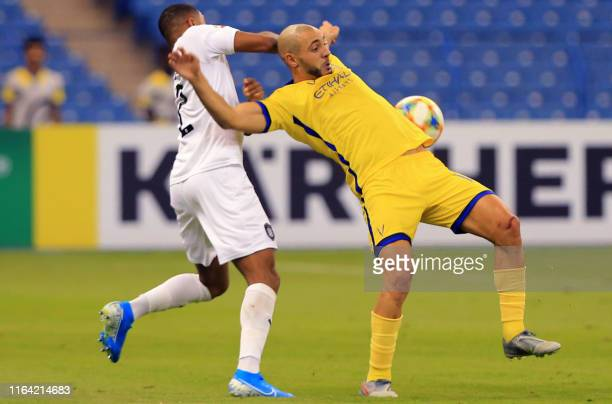 Nassr's Noureddine Amrabat vies for the ball with Sadd's defender Pedro Correia during the AFC Champions League quarterfinals football match between...