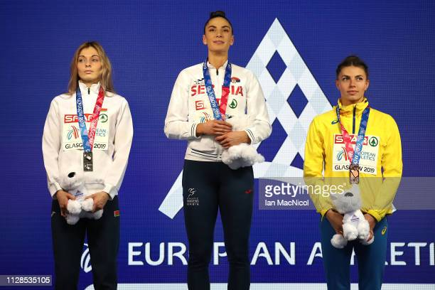 Nastassia MironchykIvanova of Belarus Ivana Spanovic of Serbia and Maryna BekhRomanchuk of Ukraine with their medals during the medal ceremony for...