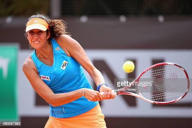Nastassja Burnett of Italy in action against Garbine Muguruza of Spain during day three of the Internazionali BNL d'Italia tennis 2014 on May 13 2014...
