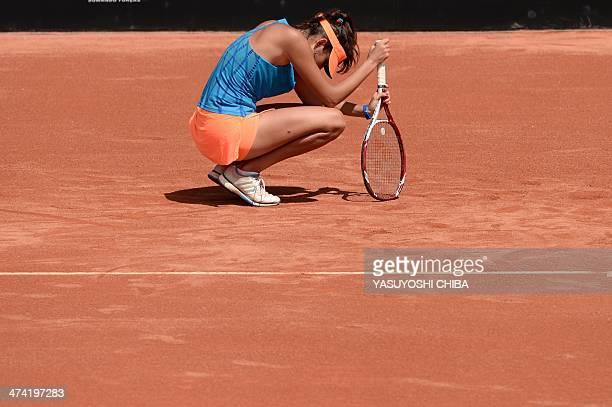 Nastassja Burnett of Italy reacts after losing to Kurumi Nara of Japan in their 2014 Rio Open women's semifinal singles tennis match in Rio de...