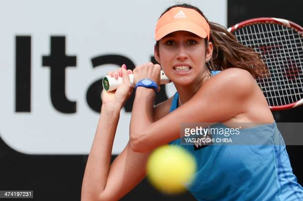 Nastassja Burnett of Italy returns the ball to Kurumi Nara of Japan during their 2014 Rio Open women's semifinal singles tennis match in Rio de...