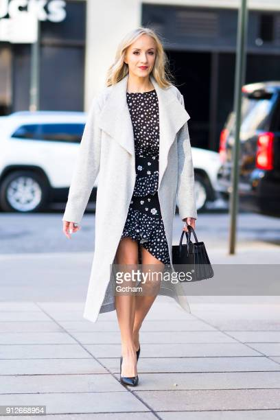 Nastia Liukin is seen wearing an Alice Olivia coat HM top and skirt with a Yves Saint Laurent handbag in SoHo on January 31 2018 in New York City