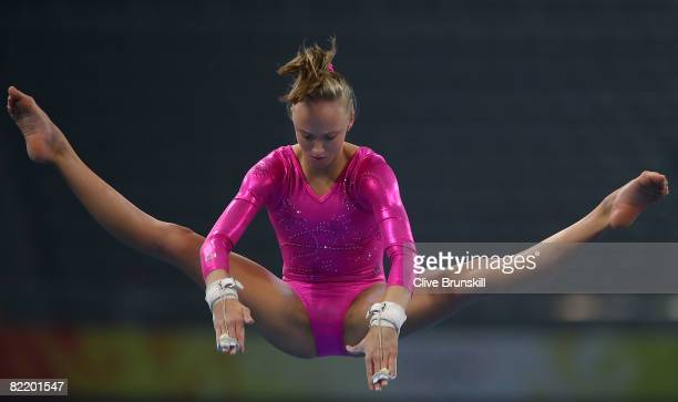 Nastia Liukin of the United States practices on the uneven bars ahead of the Beijing 2008 Olympics at the National Indoor Stadium on August 7 2008 in...