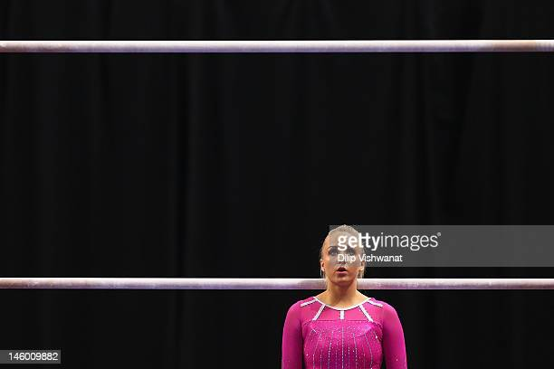 Nastia Liukin prepares to compete on the uneven bars during the Senior Women's competition on day two of the Visa Championships at Chaifetz Arena on...