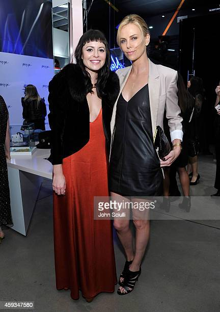 Nasty Gal Founder Sophia Amoruso and Actress Charlize Theron attends the Nasty Gal Melrose Store Launch on November 20 2014 in Los Angeles California