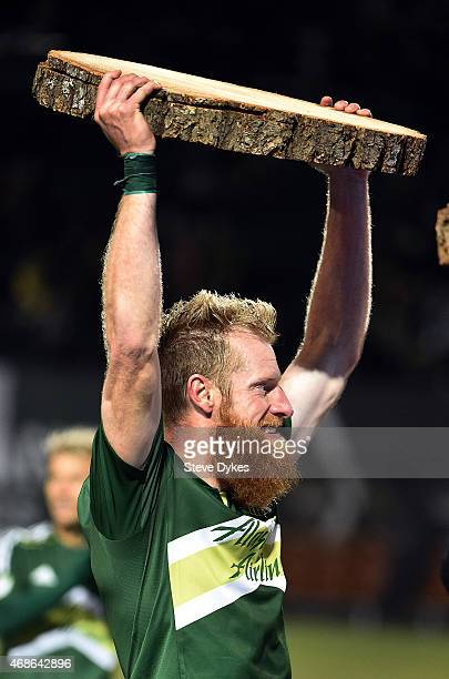 Nat Borchers of Portland Timbers holds up a Timber slab after the Timbers 31 victory in the game against the FC Dallas at Providence Park on April 4...