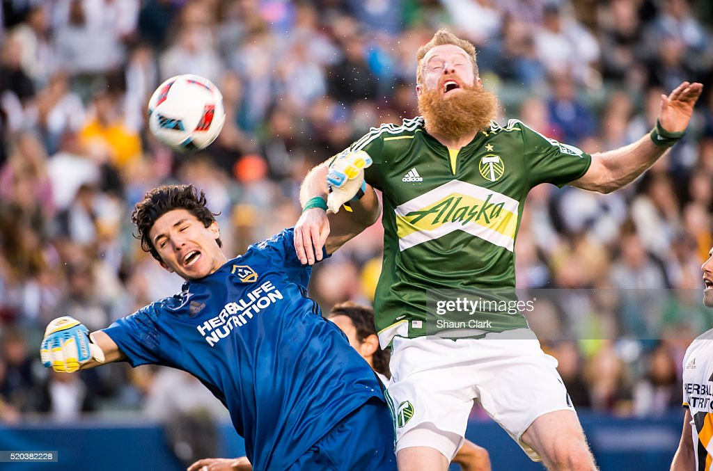 Nat Borchers #7 of Portland Timbers runs into Brian Rowe #12 of Los Angeles Galaxy during Los Angeles Galaxy's MLS match against Portland Timbers at the StubHub Center on April 10, 2016 in Carson, California. The match ended in a 1-1 tie