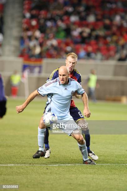 Nat Borchers of Real Salt Lake battles for the ball against Conor Casey of the Colorado Rapids at Rio Tinto Stadium on October 24 2009 in Sandy Utah