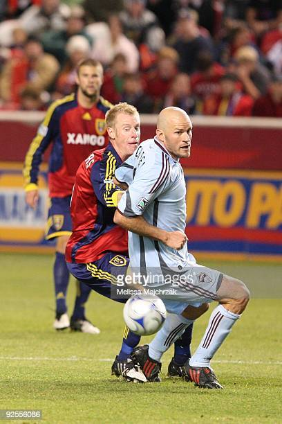 Nat Borchers of Real Salt Lake chases the ball down against Conor Casey of the Colorado Rapids at Rio Tinto Stadium on October 24 2009 in Sandy Utah