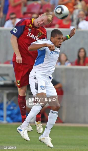 Nat Borchers of Real Salt Lake heads the ball over Ryan Johnson of San Jose Earthquakes during the first half on June 25 2010 at Rio Tinto Stadium in...