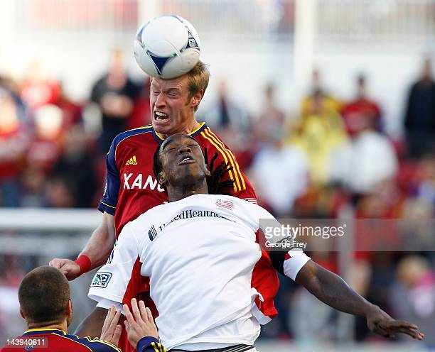 Nat Borchers of Real Salt Lake heads the ball over Shairie Joseph of the New Engeland Revolution during the first half of an MLS soccer game May 5...