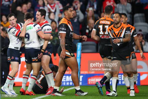 Nat Butcher of the Roosters celebrates scoring a tryduring the round 16 NRL match between the Wests Tigers and the Sydney Roosters at Bankwest...