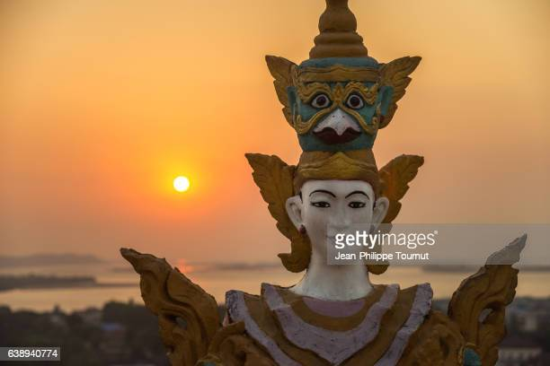nat deity statue and the sea, sunset near kyaik-than-lan pagoda in mawlamyine, mon state, southern myanmar (burma) - mystic goddess stock photos and pictures
