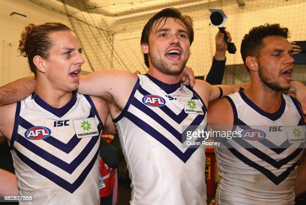 Nat Fyfe Joel Hamling and Michael Johnson of the Dockers sing the song in the rooms after winning the round eight AFL match between the Richmond...