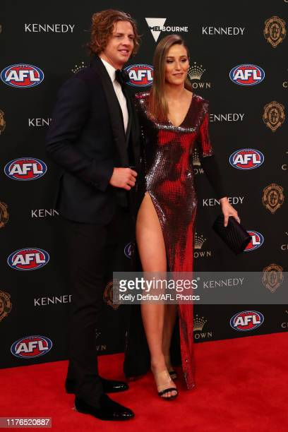 Nat Fyfe of the Dockers and Eleanor Bradshaw arrive ahead of the 2019 Brownlow Medal at Crown Palladium on September 23, 2019 in Melbourne, Australia.
