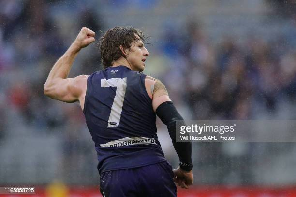 Nat Fyfe of the Dockers celebrates after scoring a goal during the round 20 AFL match between the Fremantle Dockers and the Geelong Cats at Optus...