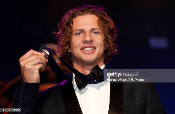 Nat Fyfe of the Dockers celebrates with his Brownlow Medal during the 2019 Brownlow Medal Count at Crown Palladium on September 23 2019 in Melbourne...