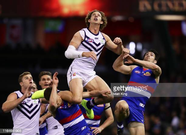 Nat Fyfe of the Dockers competes for the ball against Easton Wood of the Bulldogs during the round 19 AFL match between the Western Bulldogs and the...