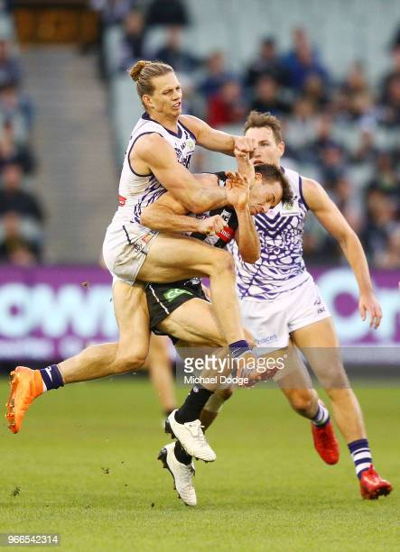 Nat Fyfe of the Dockers hits Levi Greenwood of the Magpies high in a late contest for the ball during the round 11 AFL match between the Collingwood...