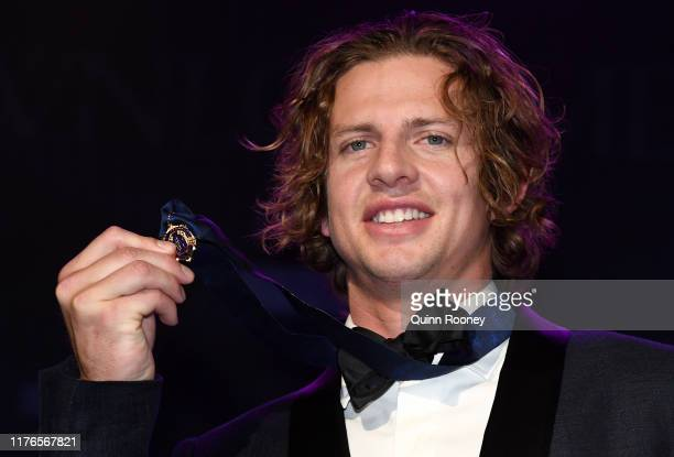 Nat Fyfe of the Dockers holds up his medal after being crowned the Brownlow medalist at the 2019 Brownlow Medal at Crown Palladium on September 23,...