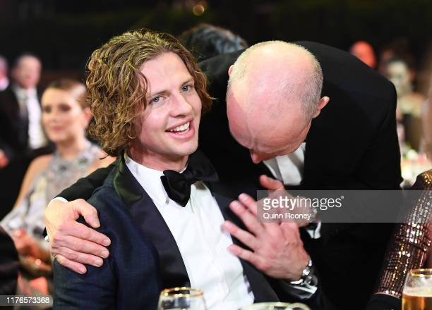 Nat Fyfe of the Dockers is congratulated by friends after being crowned the Brownlow medalist at the 2019 Brownlow Medal at Crown Palladium on...