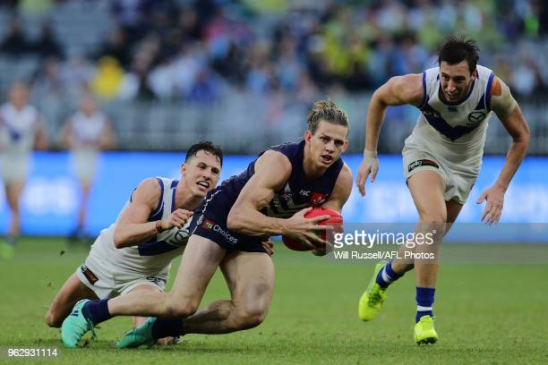 Nat Fyfe of the Dockers is tackled by Ben Jacobs of the Kangaroos during the round 10 AFL match between the Fremantle Dockers and the North Melbourne...
