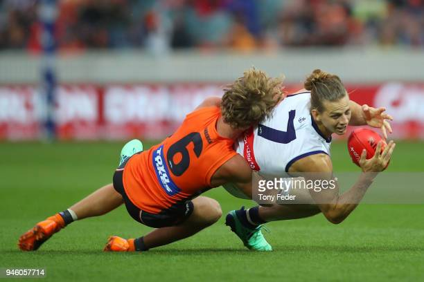 Nat Fyfe of the Dockers is tackled by Lachie Whitfield of the Giants during the round four AFL match between the Greater Western Sydney Giants and...