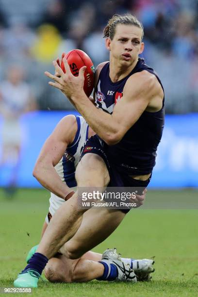 Nat Fyfe of the Dockers is tackled during the round 10 AFL match between the Fremantle Dockers and the North Melbourne Kangaroos at Optus Stadium on...
