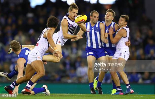 Nat Fyfe of the Dockers passes the ball during the round 16 AFL match between the North Melbourne Kangaroos and the Fremantle Dockers at Etihad...