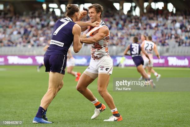 Nat Fyfe of the Dockers remonstrates with Matt de Boer of the Giants during the round 14 AFL match between the Fremantle Dockers and the Greater...