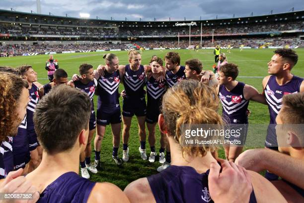 Nat Fyfe of the Dockers speaks to the huddle at the start of the game during the round 18 AFL match between the Fremantle Dockers and the Hawthorn...