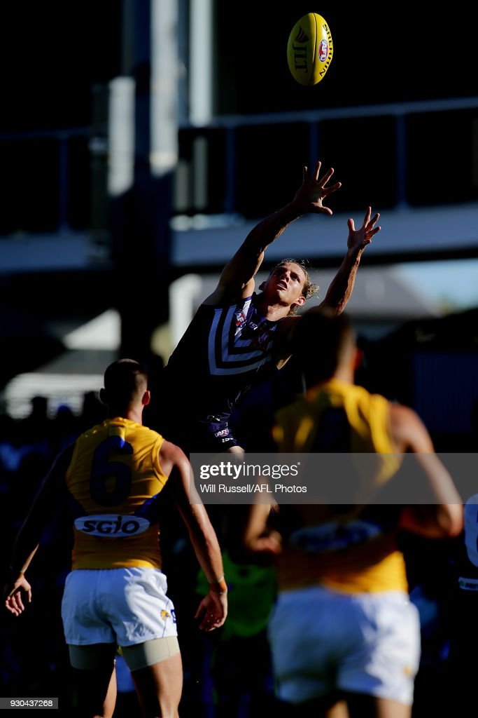 Nat Fyfe of the Dockers takes an overhead mark during the JLT Community Series AFL match between the Fremantle Dockers and the West Coast Eagles at HBF Arena on March 11, 2018 in Perth, Australia.