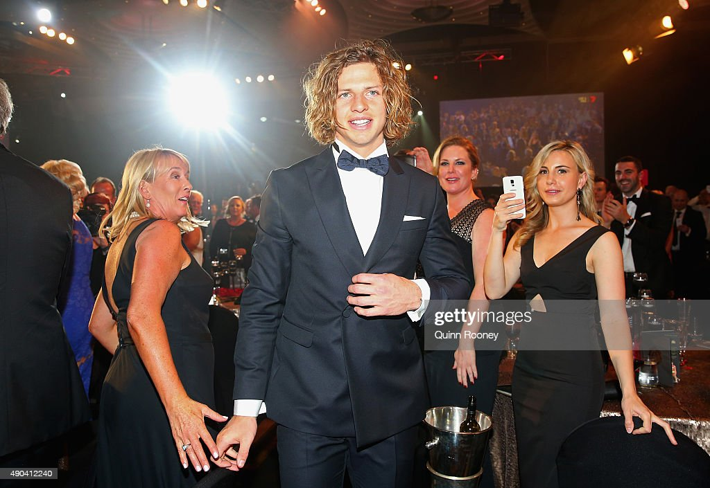 Nat Fyfe of the Dockers walks through the crowd after winning the 2015 Brownlow Medal at the 2015 Brownlow Medal at Crown Palladium on September 28, 2015 in Melbourne, Australia.