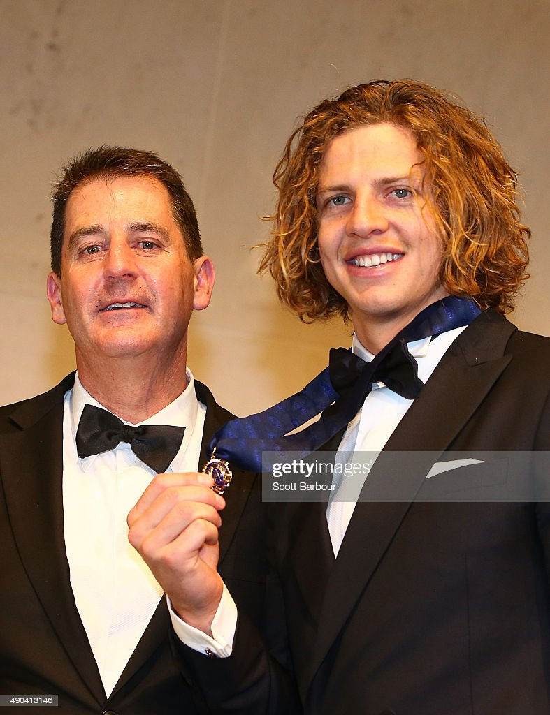Nat Fyfe of the Fremantle Dockers poses with Dockers coach Ross Lyon after winning the 2015 Brownlow Medal at the 2015 Brownlow Medal at Crown Palladium on September 28, 2015 in Melbourne, Australia.