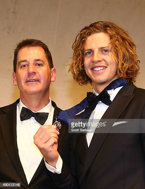 Nat Fyfe of the Fremantle Dockers poses with Dockers coach Ross Lyon after winning the 2015 Brownlow Medal at the 2015 Brownlow Medal at Crown...