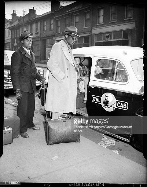 Nat King Cole and Maria Cole with Owl Cab and driver Hill District Pittsburgh Pennsylvania February 1947