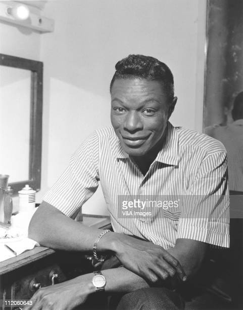 Nat King Cole posed in dressing room 1959