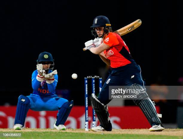 Nat Sciver of England and Tanya Bhatia of India eyes on the ball during the ICC Women's World T20 2nd semifinal match between England and India at...