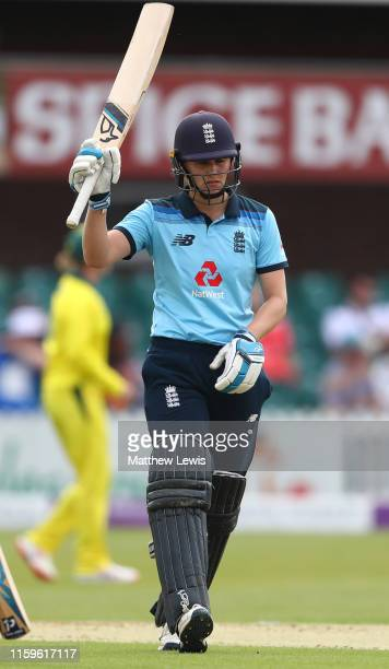 Nat Sciver of England celebrates her half century during the 1st Royal London Women's ODI between England and Australia at Fischer County Ground on...