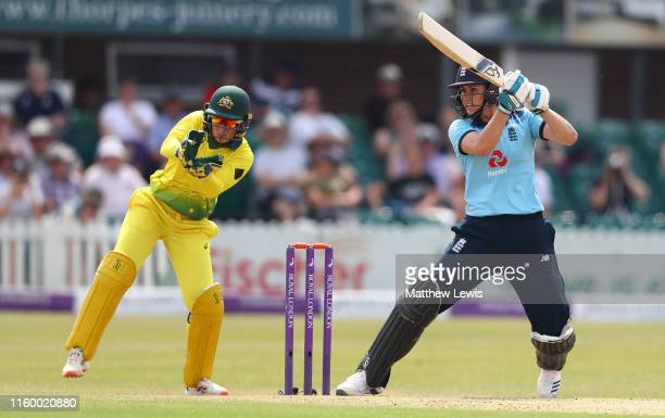 Nat Sciver of England hits the ball towards the boundary as Alyssa Healy of Australia looks on during the 2nd Royal London Women's ODI match between...