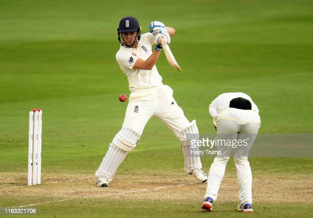 Nat Sciver of England plays a shot as Nicole Bolton of Australia avoids being hit during Day Four of the Kia Women's Test Match between England Women...